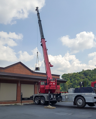 One view of our installation crew using a crane to install equipment