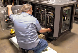 A technician servicing equipment